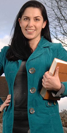 Dr Francesca Stavrakopoulou is snapped while casually reading BHS during a walk in the park
