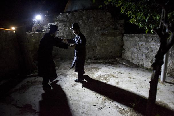 Orthodox Jewish men dance near the alleged tomb of the biblical figure Caleb in the Palestinian town of Kifl Hareth in the West Bank. JONATHAN NACKSTRAND / AFP / GETTY IMAGES