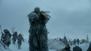 A Giant carrying poles - Game of Thrones, Season Three, Episode One